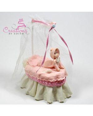 Baby girl in bassinet